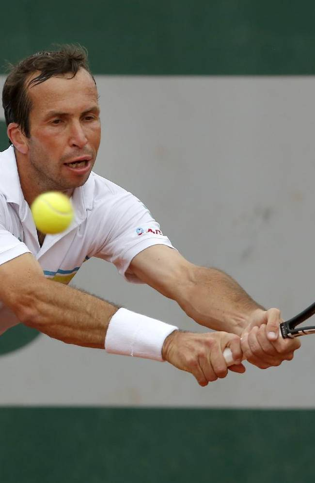 Radek Stepanek of the Czech Republic returns the ball during the first round match of  the French Open tennis tournament against Argentina's Facundo Arguello at the Roland Garros stadium, in Paris, France, Sunday, May 25, 2014