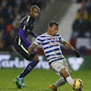 QPR's Eduardo Vargas, right, runs with the ball during the English Premier League soccer match between Queens Park Rangers and Manchester City at Loftus Road stadium in London, Saturday, Nov. 8, 2014