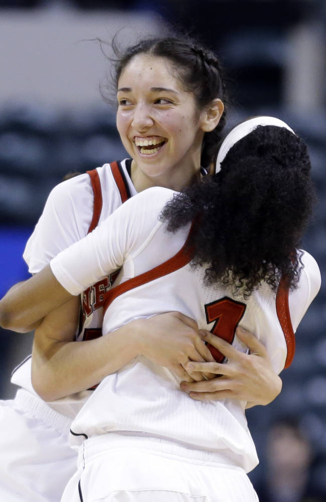 Nebraska forward Jordan Hooper, left, hugs guard Tear'a Laudermill after they defeated Iowa in an NCAA college basketball game in the finals of the Big Ten women's tournament in Indianapolis, Sunday, March 9, 2014. Nebraska won 72-65