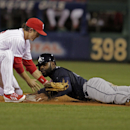 Atlanta Braves' Justin Upton right, steals second as Philadelphia Phillies' Chase Utley makes a late tag in the third inning of a baseball game Monday, April 14, 2014, in Philadelphia The Associated Press