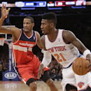 New York Knicks' Iman Shumpert (21) drives past Washington Wizards' Trevor Ariza (1) during the first half of an NBA basketball game Friday, April 4, 2014, in New York The Associated Press
