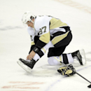 Pittsburgh Penguins center Sidney Crosby (87) adjusts his skates during warms up before during an NHL hockey game against the Washington Capitals, Monday, March 10, 2014, in Washington The Associated Press