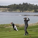 Former Secretary of State Condoleezza Rice hits from the fifth tee of the Pebble Beach Golf Links during the first round of the AT&T Pebble Beach Pro-Am golf tournament Thursday, Feb. 7, 2013, in Pebble Beach, Calif. (AP Photo/Eric Risberg)