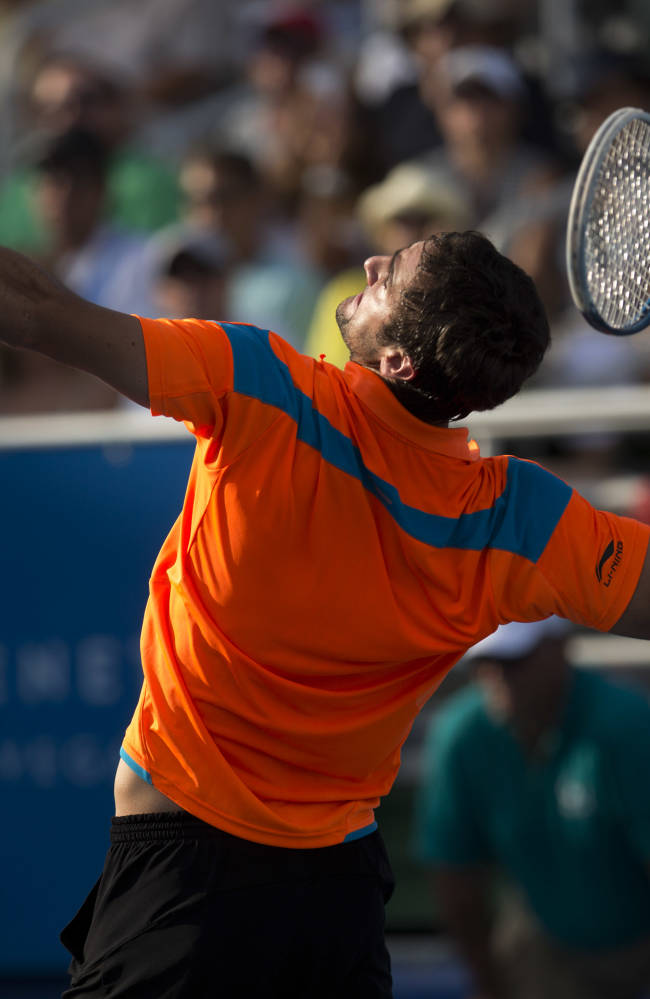Marin Cilic, of Croatia, serves to Kevin Anderson during the Delray Beach, Fla., Open tennis tournament, Sunday, Feb. 23, 2014