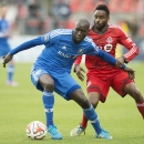 Montreal Impact's Hassoun Camara, left, protects the ball from Toronto FC's Warren Creavalle during the first half of an MLS soccer match, Saturday, Oct. 18, 2014, in Toronto The Associated Press