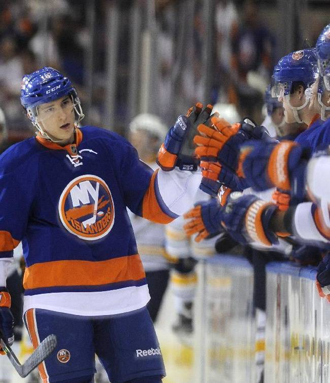 New York Islanders' Ryan Strome (18) celebrates his goal against the Buffalo Sabres with teammates in the third period of an NHL hockey game on Saturday, March 15, 2014, in Uniondale, N.Y. The Islanders won 4-1