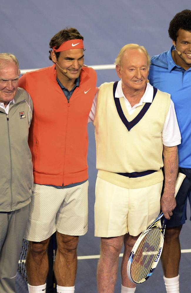 CORRECTS SPELLING OF ROCHE - Former Australian tennis greats, Rod Laver, third right, Tony Roche, second left, and Pat Rafter, left, smile with Roger Federer, third left, of Switzerland, Jo-Wilfried Tsonga, second right, of France and Lleyton Hewitt, right, of Australia during a gala charity exhibition match in the lead up to the Australian Open at Rod Laver Arena in Melbourne, Australia, Wednesday, Jan 8, 2014.The charity event for the Roger Federer Foundation and the Australian Tennis Foundation will raise money for the education of African children