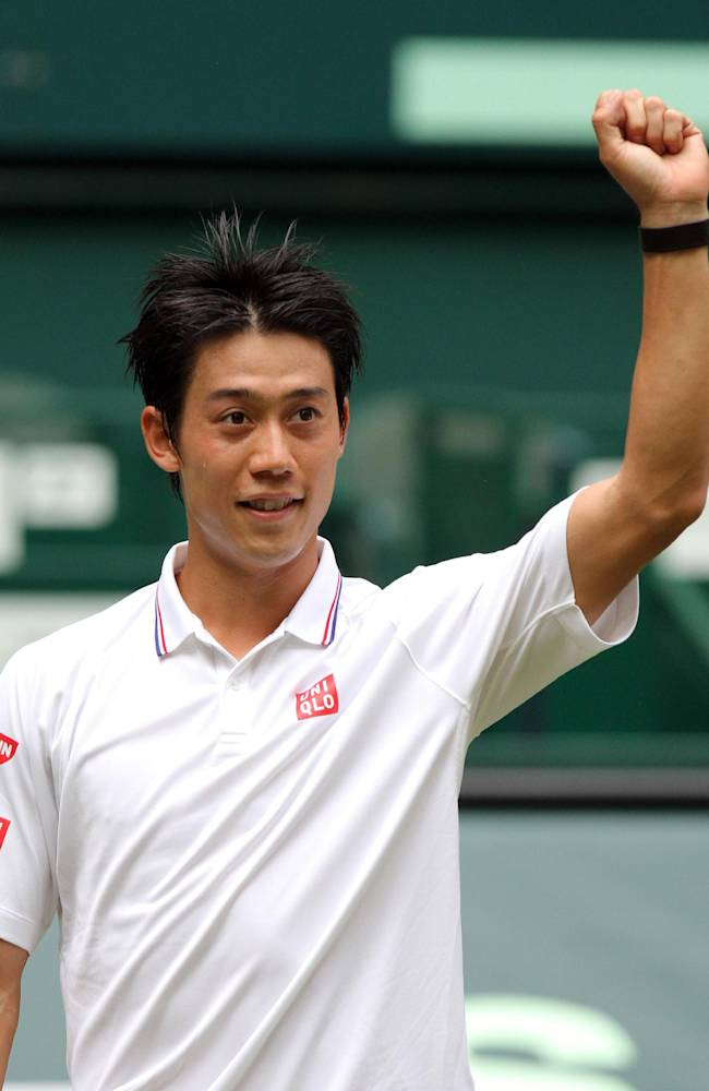 Japan's Kei Nishikori celebrates after winning against Steve Johnson from the US during their quarterfinal match at the Gerry Weber Open tennis tournament in Halle, Germany, Friday, June 13, 2014. Nishikori won the match with 6-1 and 6-7