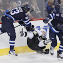 Winnipeg Jets' Dustin Byfuglien (33) takes out Pittsburgh Penguins' Jussi Jokinen (36) with a check as Jets' Olli Jokinen (12) avoids them during the first period of an NHL hockey game in Winnipeg, Manitoba, on Thursday, April 3, 2014 The Associated Press