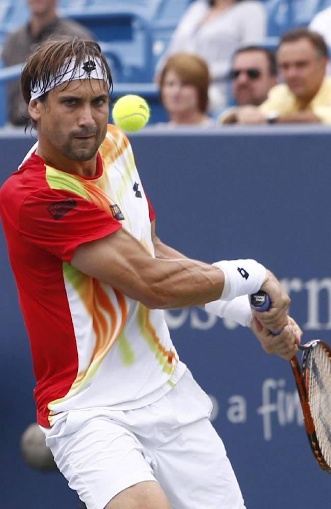 David Ferrer, from Spain, returns a volley to Julien Benneteau, from France, during a semifinal match at the Western & Southern Open tennis tournament, Saturday, Aug. 16, 2014, in Mason, Ohio