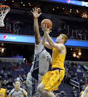 Lipscomb guard Talbott Denny, right, goes to the basket against Georgetown center Joshua Smith (24) during the first half of an NCAA college basketball game, Saturday, Nov. 30, 2013, in Washington. (AP Photo/Nick Wass)