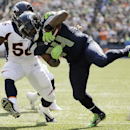 Seattle Seahawks running back Marshawn Lynch (24) runs the ball as Denver Broncos middle linebacker Nate Irving (56) closes in during the first half of an NFL football game, Sunday, Sept. 21, 2014, in Seattle The Associated Press