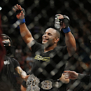 Daniel Cormier celebrates after defeating Anthony Johnson in their light heavyweight mixed martial arts title bout at UFC 187 on Saturday, May 23, 2015, in Las Vegas. (AP Photo/John Locher)
