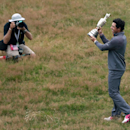 Rory McIlroy of Northern Ireland is photographed as he holds the Claret Jug trophy after winning the British Open Golf championship at the Royal Liverpool golf club, Hoylake, England, Sunday July 20, 2014