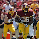 Washington Redskins running back Alfred Morris (46) runs away from Jacksonville Jaguars free safety Josh Evans (26) during the first half of an NFL football game Sunday, Sept. 14, 2014, in Landover, Md The Associated Press
