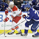 Carolina Hurricanes defenseman Ron Hainsey (65) carries the puck past Tampa Bay Lightning defenseman Victor Hedman (77), of Sweden, during the first period of an NHL hockey game Thursday, Dec. 11, 2014, in Tampa, Fla The Associated Press