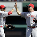 Cincinnati Reds' Billy Hamilton, left, and teammate Jay Bruce celebrate following a 4-0 victory over the St. Louis Cardinals in a baseball game on Wednesday, April 9, 2014, in St. Louis The Associated Press