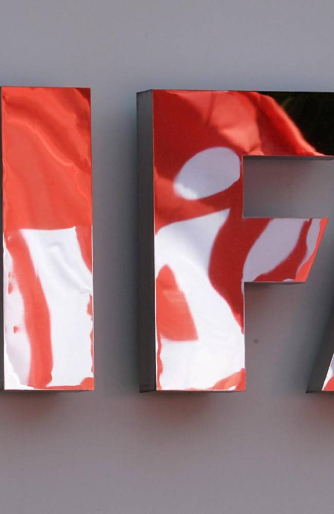 Flags of the union UNIA are reflected in the FIFA logo during a demonstration in front of the FIFA headquarters against the working conditions for the soccer World Cup 2022 in Qatar, Thursday, Oct. 3, 2013. FIFA opened a two-day board meeting Thursday that will discuss whether to move the 2022 World Cup in Qatar from the traditional summer dates. FIFA President Sepp Blatter has been pushing for a switch but will likely meet opposition from Europe and the United States. They want FIFA to consult widely before agreeing to a change from the usual June-July slot to avoid the extreme heat in the tiny desert nation