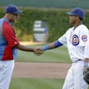Chicago Cubs manager Dale Sveum greets shortstop Starlin Castro after the Cubs' 4-2 win over the Pittsburgh Pirates in their last home baseball game of the season, Wednesday, Sept. 25, 2013, in Chicago The Associated Press