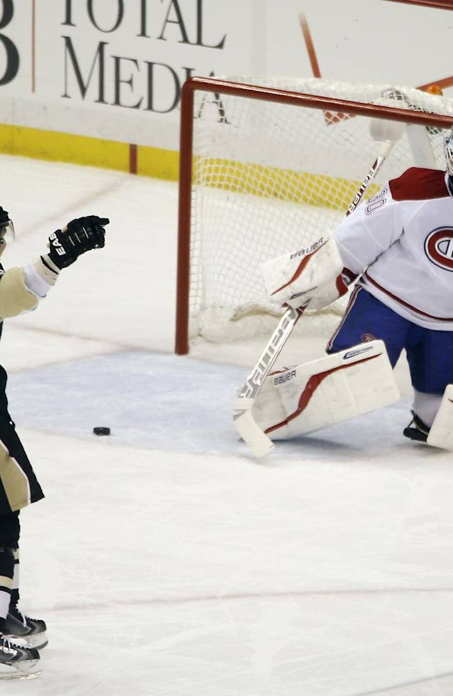 Pittsburgh Penguins' Jussi Jokinen (36), of Finland celebrates after Deryk Engelland scored past Montreal Canadiens goalie Peter Budaj, of Slovakia, during the first period of an NHL hockey game, Thursday, Feb. 27, 2014 in Pittsburgh