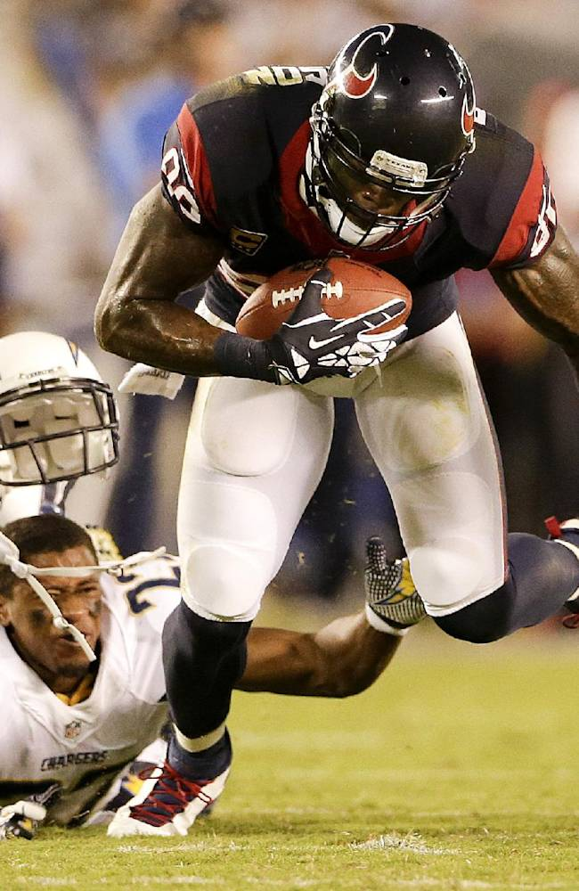 Houston Texans wide receiver Andre Johnson, right, breaks away from San Diego Chargers cornerback Derek Cox during the second half of an NFL football game Monday, Sept. 9, 2013, in San Diego