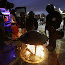 Chicago Bears fans try to stay warm as they tailgate around the fire outside Soldier Field before an NFL football game against the Dallas Cowboys, Monday, Dec. 9, 2013, in Chicago The Associated Press