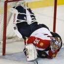 Florida Panthers goalie Al Montoya lies on Calgary Flames' Lance Bouma during the third period of an NHL hockey game Friday, Jan. 9, 2015, in Calgary, Alberta The Associated Press