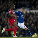 Everton's Ross Barkley, right, scores past Queens Park Rangers' Nedum Onuoha during the English Premier League soccer match between Everton and Queens Park Rangers at Goodison Park Stadium, Liverpool, England, Monday Dec. 15, 2014