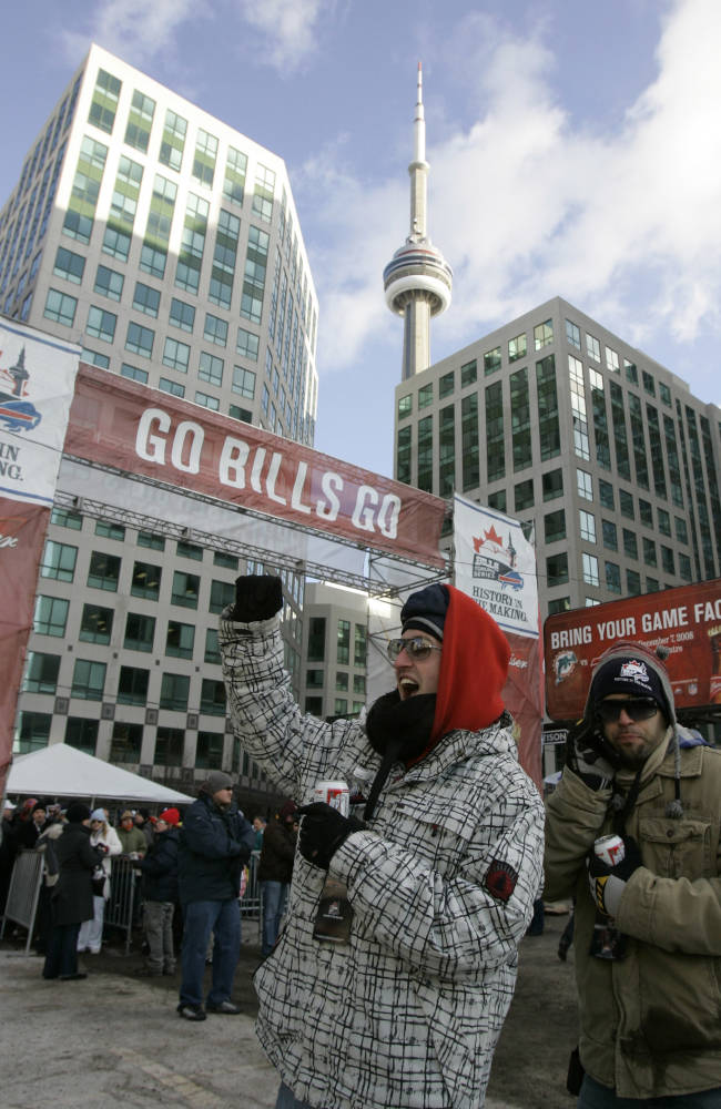 In this Dec. 7, 2008, file photo, football fans gather outside Rogers Stadium in Toronto for a tailgate party before the NFL football game between the Buffalo Bills and Miami Dolphins. The Bills take on the Atlanta Falcons in a
