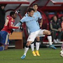 Manchester City's David Silva holds off CSKA's Ahmed Musa, left, during the Champions League Group E soccer match between CSKA Moscow and Manchester City at Arena Khimki stadium in Moscow, Russia, Tuesday Oct. 21, 2014