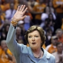 Tennessee head coach emeritus Pat Summitt waves to fans as a banner in her honor was raised before an NCAA college basketball game between the Tennessee and Notre Dame on Monday, Jan. 28, 2013, in Knoxville, Tenn. (AP Photo/Wade Payne)