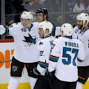 San Jose Sharks' Tomas Hertl (48), Scott Hannan (27), Tommy Wingels (57) and Joe Thornton (19) celebrate after Hertl scored a breakaway goal during first period NHL hockey action in Winnipeg, Manitoba, Sunday, Nov.10, 2013 The Associated Press