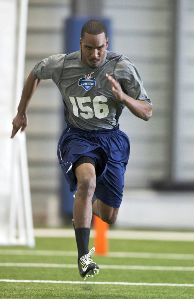 Washington State wide receiver Isiah Barton runs the 40-yard dash Saturday, March 22, 2014, during practice drills at an NFL football regional combine in Renton, Wash