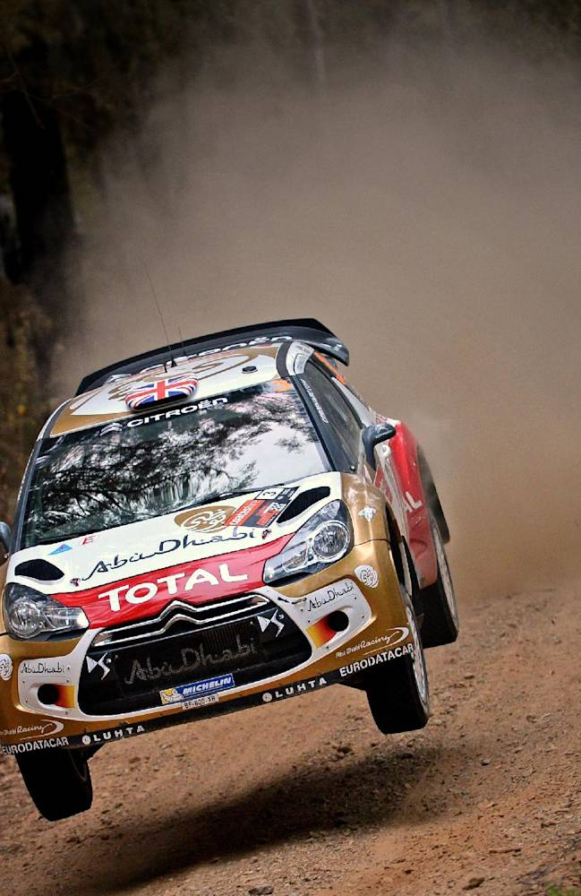 In this photo provided by Rally Australia, Kris Meeke of Britain races his car during a road stage of the Rally Australia near Coffs Harbour, Friday, Sept. 13, 2013. Meeke is in third place, 25.9 seconds behind Sebastien Ogier