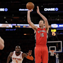Steve Novak (16) shoots as New York Knicks' Tim Hardaway Jr. (5) closes in during the second half of an NBA basketball game Wednesday, April 16, 2014, in New York. The Knicks won the game 95-92 The Associated Press