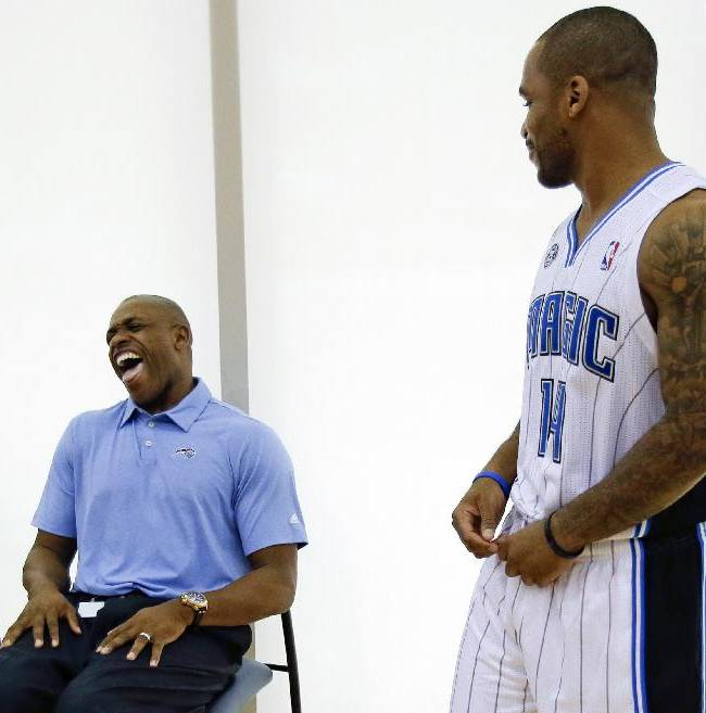 Orlando Magic's Jameer Nelson, right, jokes with former Magic player Nick Anderson, now with the Orlando Magic's community relations department, at the team's NBA basketball media day, Monday, Sept. 30, 2013, in Orlando, Fla