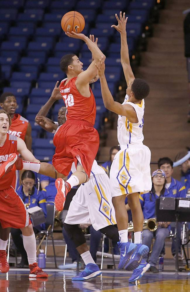 New Mexico guard Kendall Williams (10) takes a shot over San Jose State guard Isaac Thornton (20) during the second half of an NCAA college basketball game, Saturday, Jan. 11, 2014, in San Jose, Calif. New Mexico won 69-65
