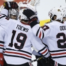 Toews' late goal lifts Blackhawks past Jets 4-3 The Associated Press