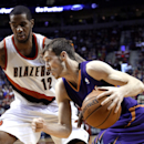 Phoenix Suns guard Goran Dragic, from Solvenia, drives on Portland Trail Blazers forward LaMarcus Aldridge during the first half of an NBA basketball game in Portland, Ore., Friday, April 4, 2014 The Associated Press