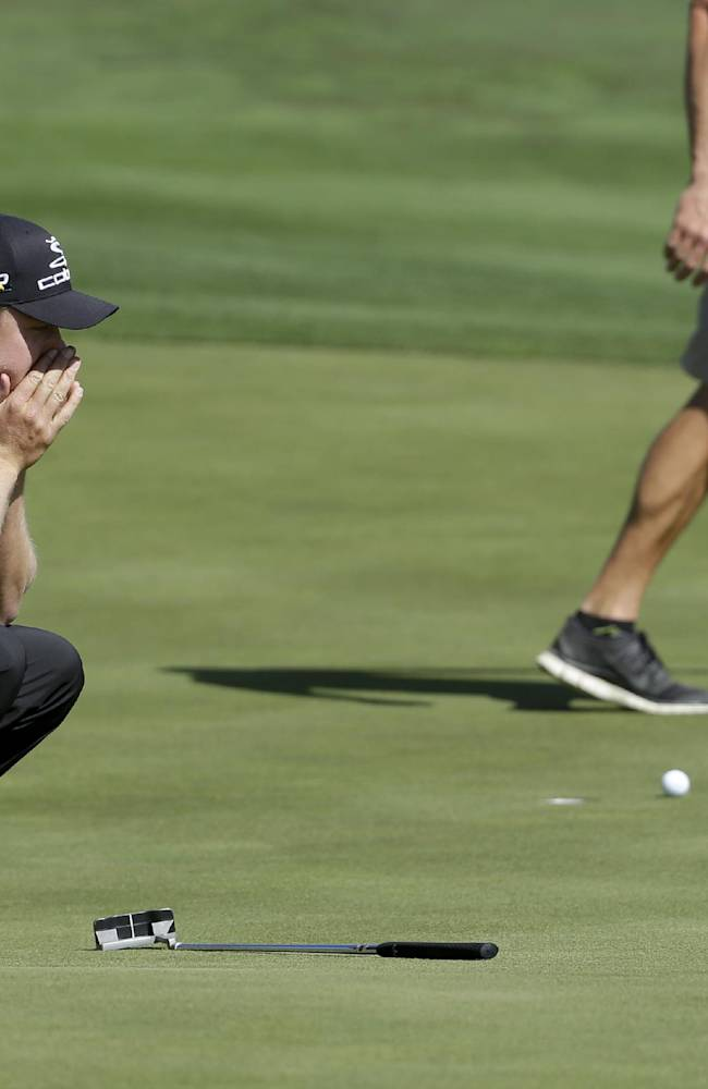 Jonas Blixt, of Sweden, reacts to a missed birdie putt on the 16th hole in his second-round match against Bubba Watson during the Match Play Championship golf tournament Thursday, Feb. 20, 2014, in Marana, Ariz