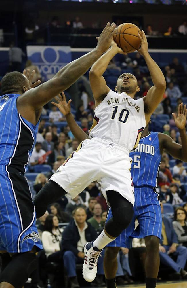 New Orleans Pelicans shooting guard Eric Gordon (10) shoots over Orlando Magic power forward Glen Davis (11) in the first half of an NBA basketball game in New Orleans, Sunday, Jan. 26, 2014