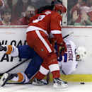 New York Islanders defenseman Johnny Boychuk (55) is checked by Detroit Red Wings center Pavel Datsyuk (13) of Russia during the third period of an NHL hockey game, Saturday, Jan. 31, 2015, in Detroit The Associated Press