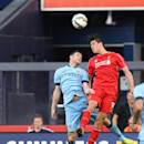 IMAGE DISTRIBUTED FOR GUINNESS INTERNATIONAL CHAMPIONS CUP - Midfielder James Milner (7) of Manchester City and defender Martin Kelly (34) of Liverpool FC go up for a header during the Guinness International Champions Cup on Wednesday, July 30, 2014 at th