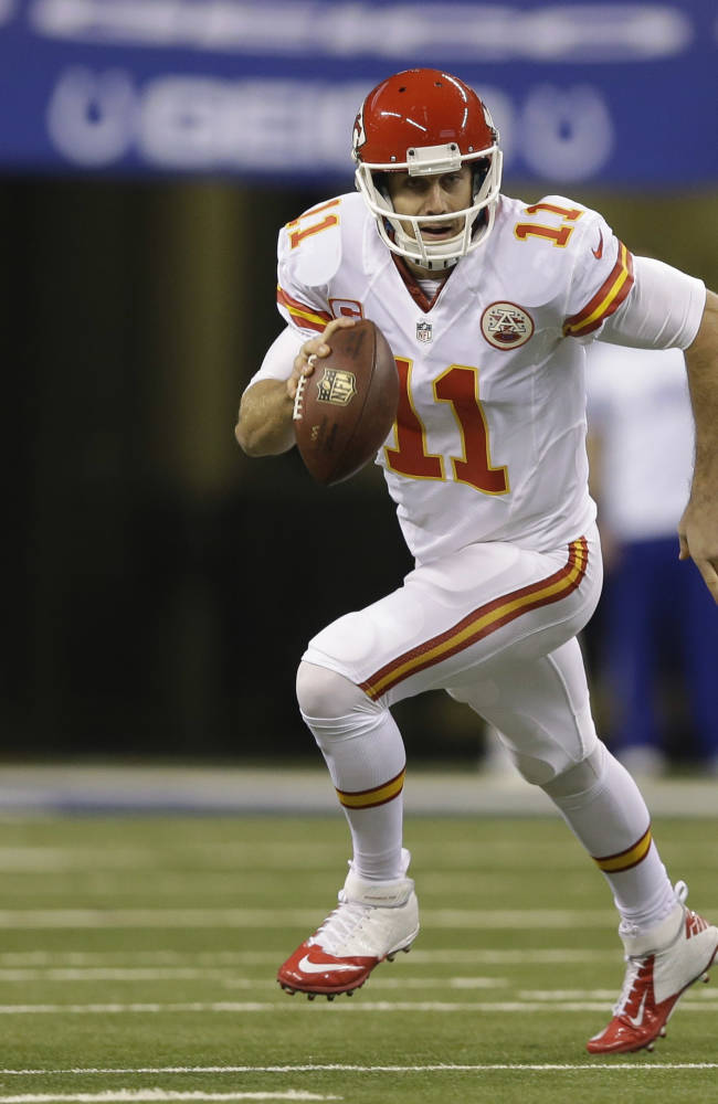 Kansas City Chiefs quarterback Alex Smith (11) runs with the ball against the Indianapolis Colts during the first half of an NFL wild-card playoff football game Saturday, Jan. 4, 2014, in Indianapolis