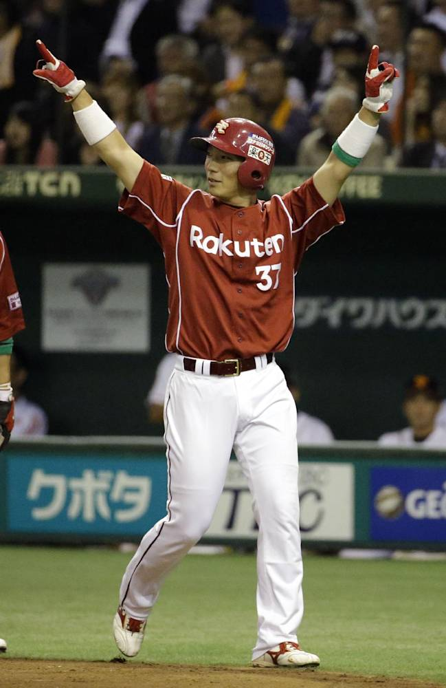 Rakuten Eagles' Motohiro Shima, right, and Kazuo Matsui, left, celebrate after scoring on a two-run double by Ginji Akaminai, in the second inning of Game 3 of baseball's Japan Series at Tokyo Dome in Tokyo, Tuesday, Oct. 29, 2013