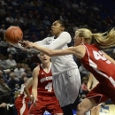 Penn State's Alex Bentley (20) reaches for a rebound past Wisconsin's Nicole Bauman (4) and Cassie Rochel (43) during the first half of an NCAA college basketball game in State College, Pa., Thursday, Jan. 17, 2013. (AP Photo/Ralph Wilson)