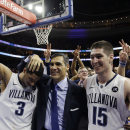 Villanova head coach Jay Wright, center, celebrates with Josh Hart, left, and Ryan Arcidiacono after an NCAA college basketball game against Syracuse, Saturday, Dec. 20, 2014, in Philadelphia. Villanova won 82-77 in overtime. (AP Photo/Matt Slocum)