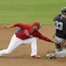 New York Yankees' Kelly Johnson, right, steals second base ahead of the tag by Philadelphia Phillies shortstop Freddy Galvis during the fourth inning of an exhibition baseball game Thursday, March 6, 2014, in Clearwater, Fla The Associated Press