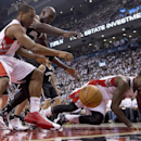 Toronto Raptors forward Amir Johnson, right, and guard Kyle Lowry competefor a loose ball with Brooklyn Nets forward Kevin Garnett during the first half of Game 2 in an NBA basketball first-round playoff series, Tuesday, April 22, 2014, in Toronto The Ass