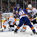 Philadelphia Flyers goalie Rob Zepp, left, defends the net as New York Islanders center John Tavares (91) and Flyers defenseman Luke Schenn (22) battle for the puck and Islanders center Brock Nelson (29) watches from behind during the second period of an